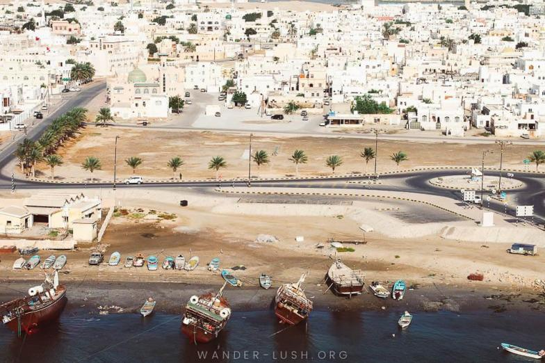 Dhow boats in Sur, Oman. Photo credit: Copyright Emily Lush | Oman road trip