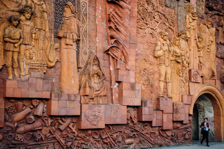 A large bas relief made from orange stone.
