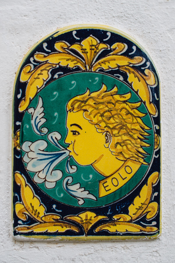 A green and yellow tile depicting a boy's face.