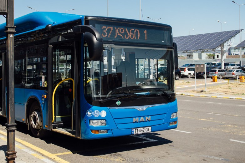 Tbilisi bus 37, a blue and black coach, waiting to pick up passengers.
