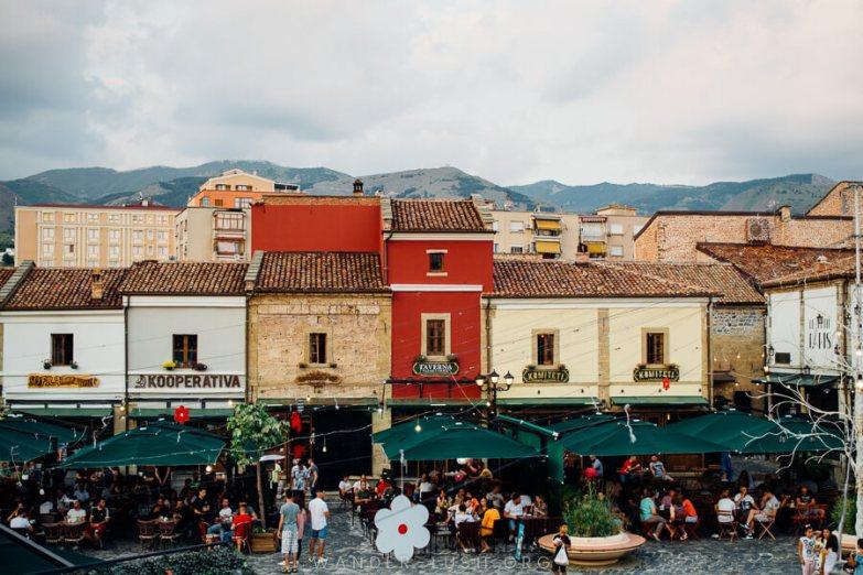 Korca Old Bazaar – colourful facades repurposed as cafes.