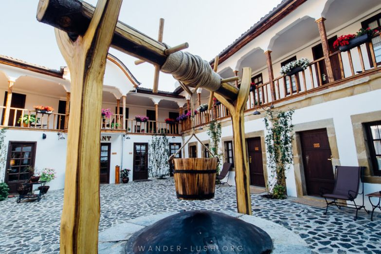 A well at the centre of a historic inn.