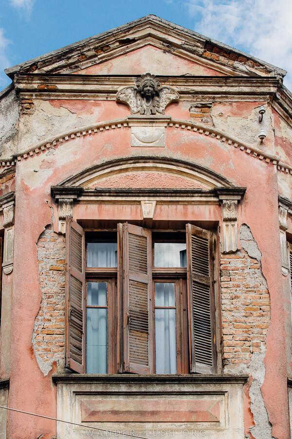 A crumbling pink facade.