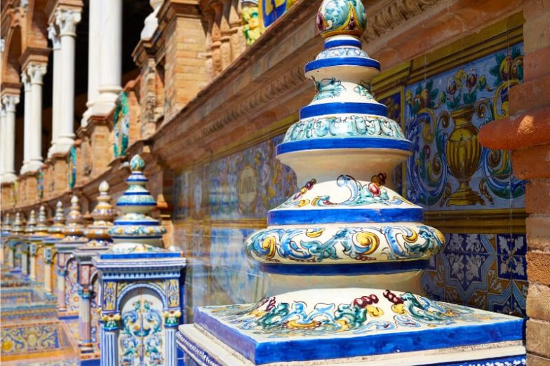 A close-up of a painted ornament in Seville, Spain.