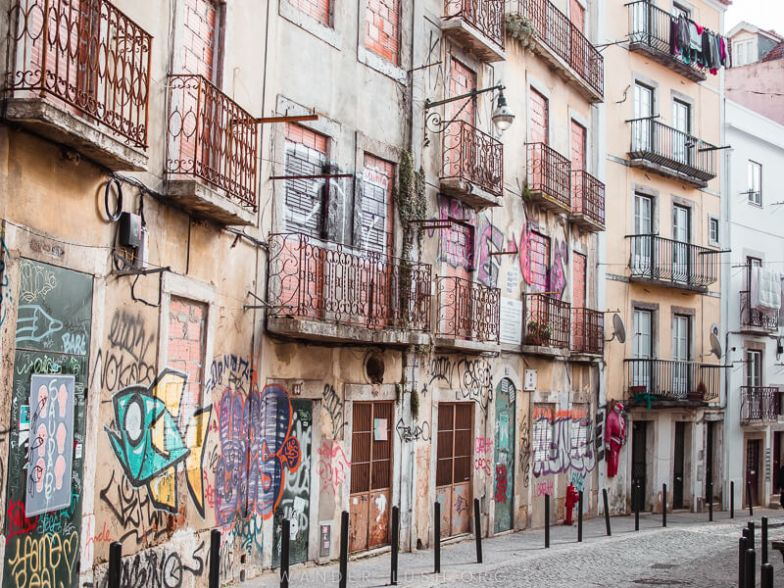 Houses and street art in Lisbon, Portugal.