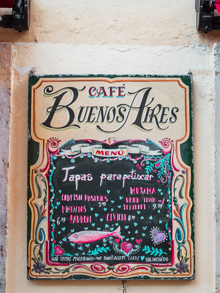 A restaurant menu for 'Cafe Buenos Aires' in Lisbon, Portugal.