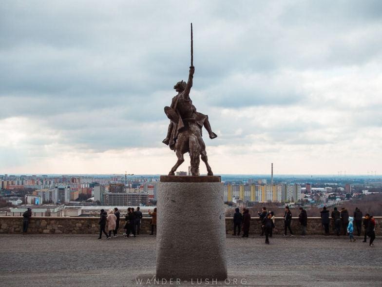 A statue of a man on a horse raising a sword outside Bratislava Castle.