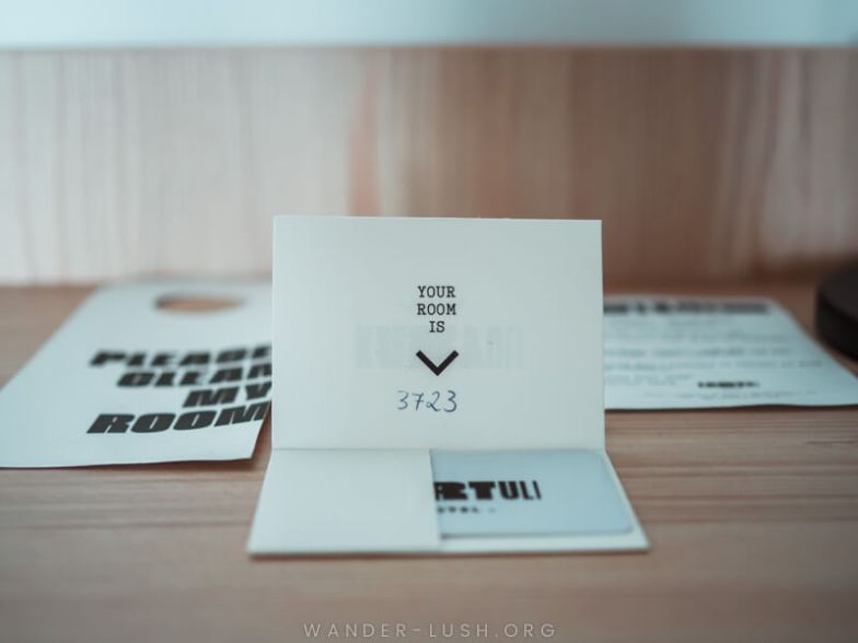 A room card with modern typography.