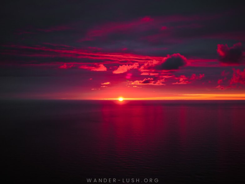 A pink and purple sunset over the ocean.
