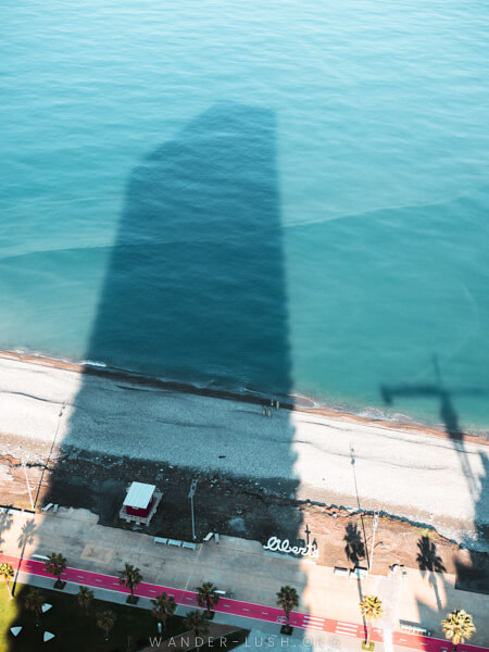 A skyscraper casts a shadow over Batumi, Georgia.