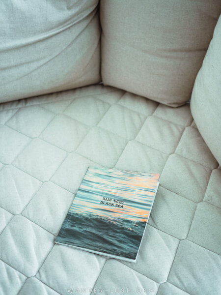 A book lying on a white sofa