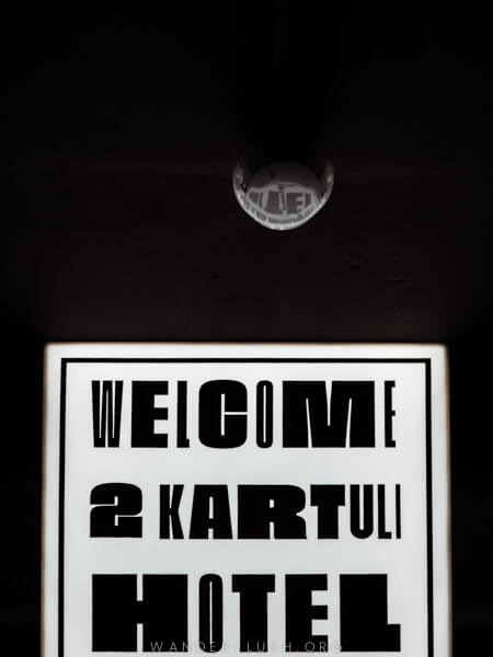 A white lightbox reads 'Welcome 2 Kartuli Hotel'
