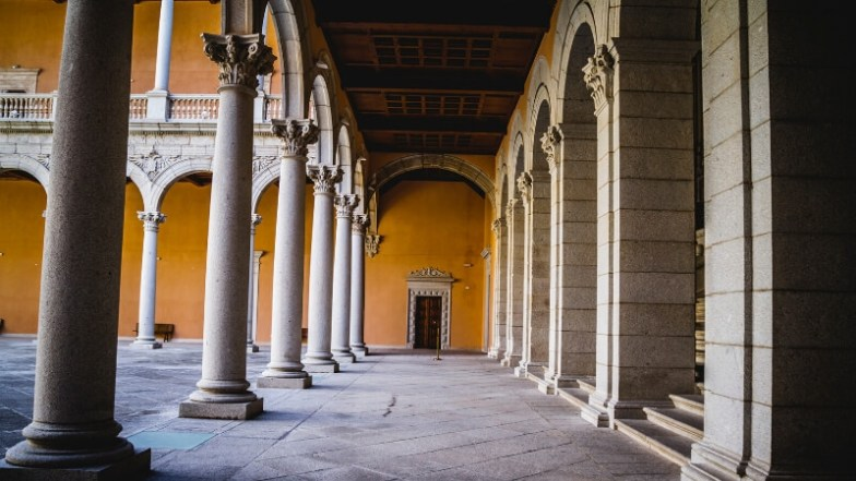 A cloister with stone columns in Toledo, Spain.