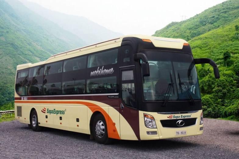 Hanoi to Sapa Express bus on a mountain road in Vietnam.