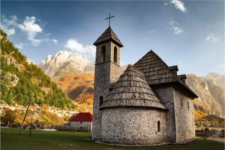 A round stone church in Theth, Albania.