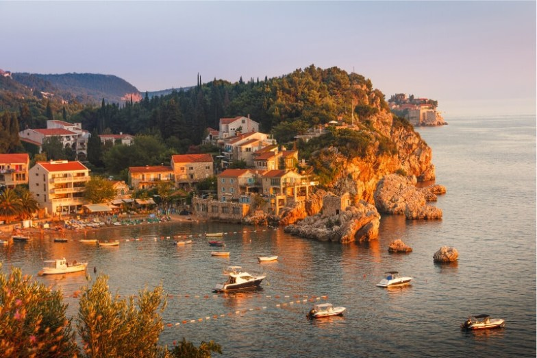 A fishing town perched on a rocky cliff in Montenegro.