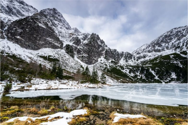Snow-capped mountains and a frozen lake in Poland.
