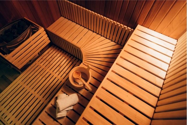 The wooden interior of a traditional Scandinavian sauna.