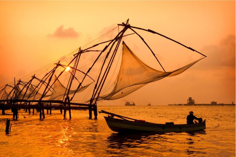 A row of traditional fishing nets on the water at dusk.