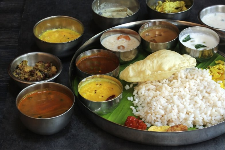 A traditional Keralan feast served on banana leaves.