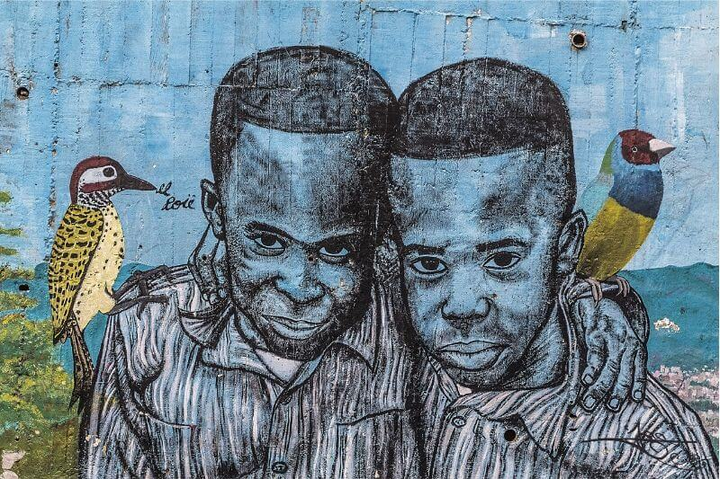 Street art depicting two boys in Colombia.
