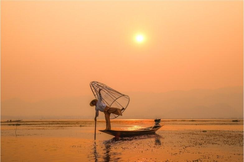 A fisherman on Inle Lake, Myanmar at dusk.