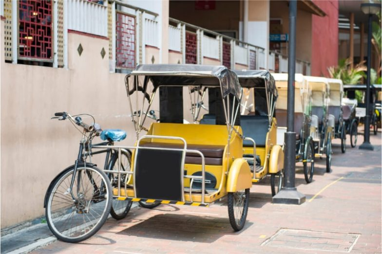 A row of yellow pedicabs in Singapore.