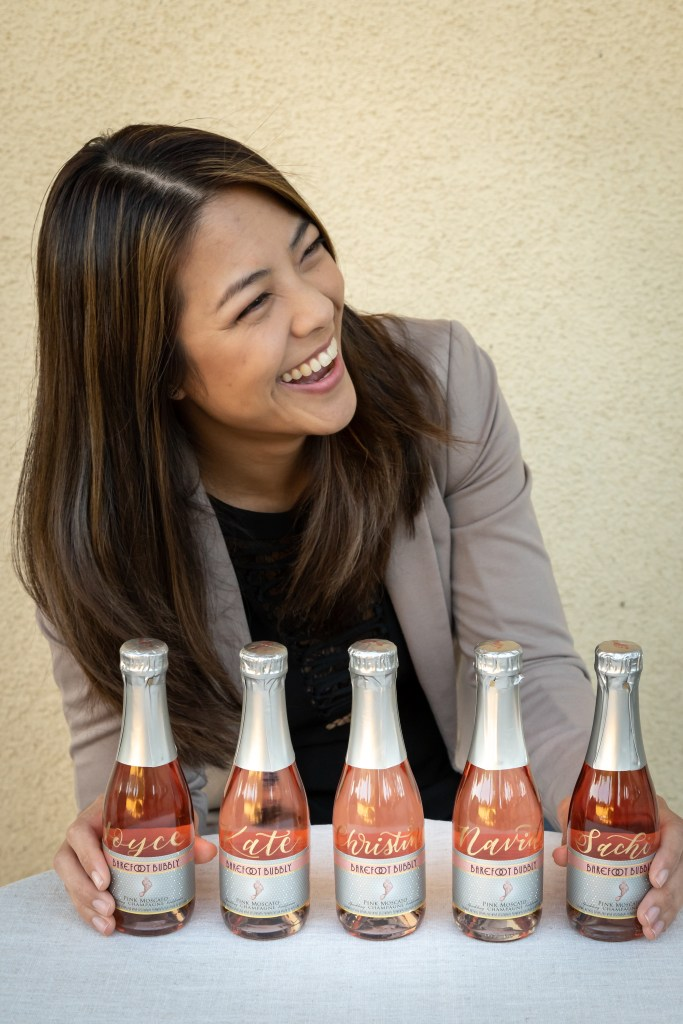Rosie Chhun LA Calligrapher custom rose wine bottles for corporate gifting