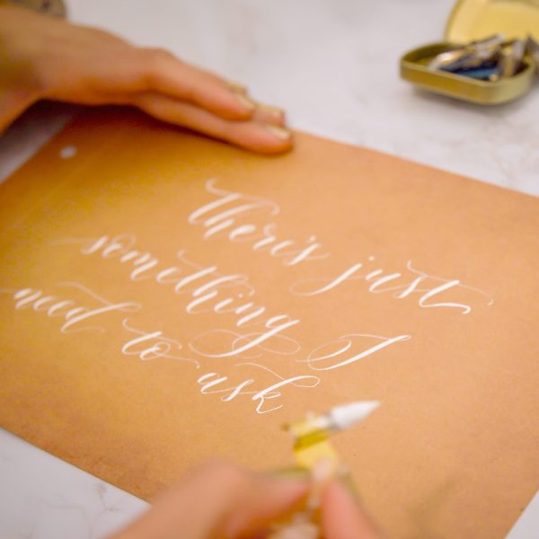 Pointed Pen calligraphy Live calligrapher and engraver Los Angeles on-site brand activation