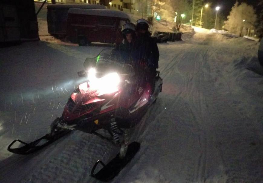 Me and Scott on a snowmobile in Finland