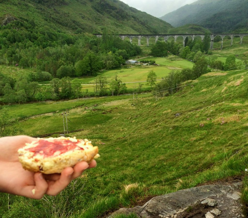Eating scones whilst looking at Glenfinnan Viaduct, Scotland