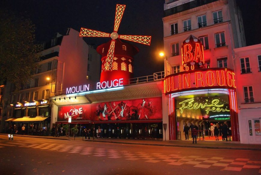Moulin Rouge Theatre and windmill at night
