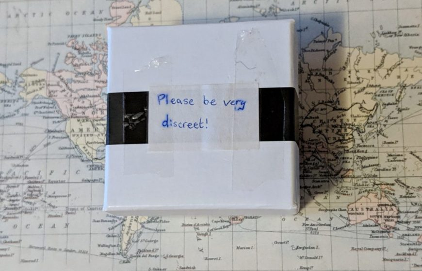 "Engagement ring box that says ""Please be very discreet!"" on it"