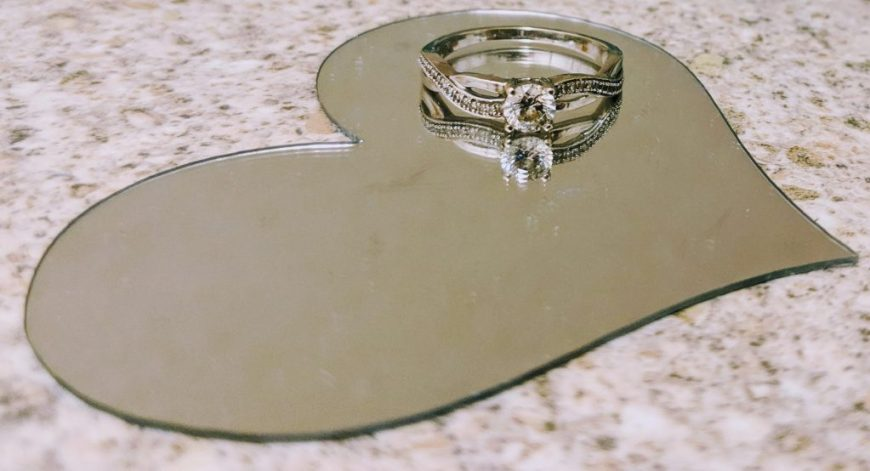 Justine's engagement ring on top of a silver heart