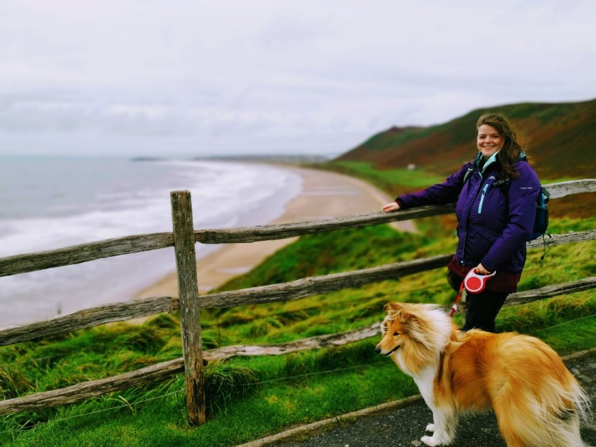 Justine and Kai looking at Rhossili Beach