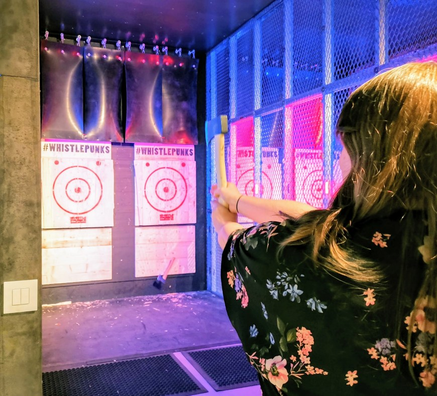 Justine doing urban axe throwing in Bristol