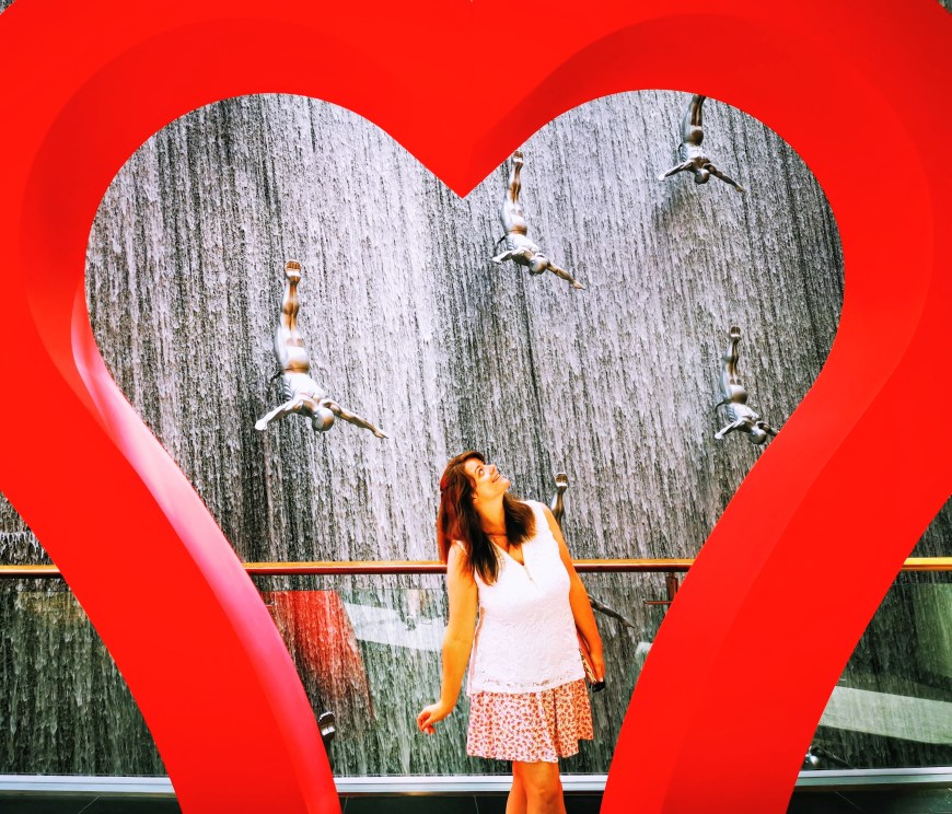 Justine and the large red heart at Dubai Mall