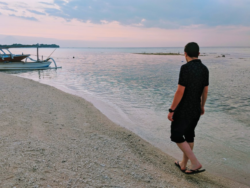 Scott walking along the beach in Gili Meno