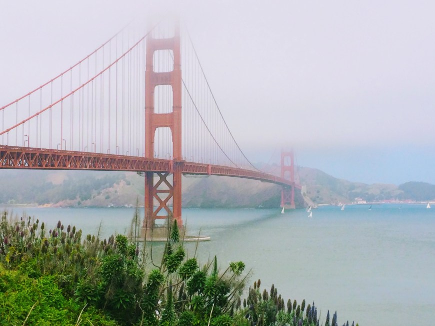 Golden Gate Bridge covered in fog at the top