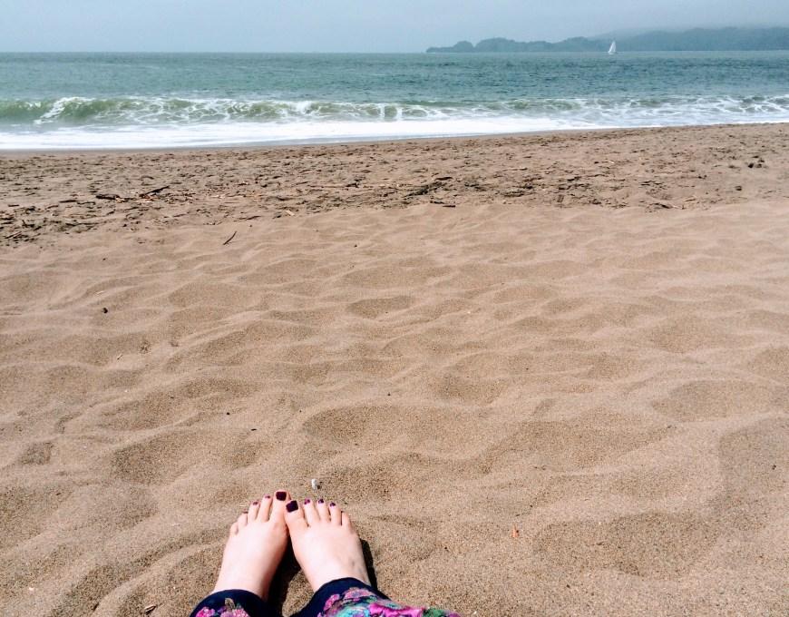 Justine sitting on Baker Beach