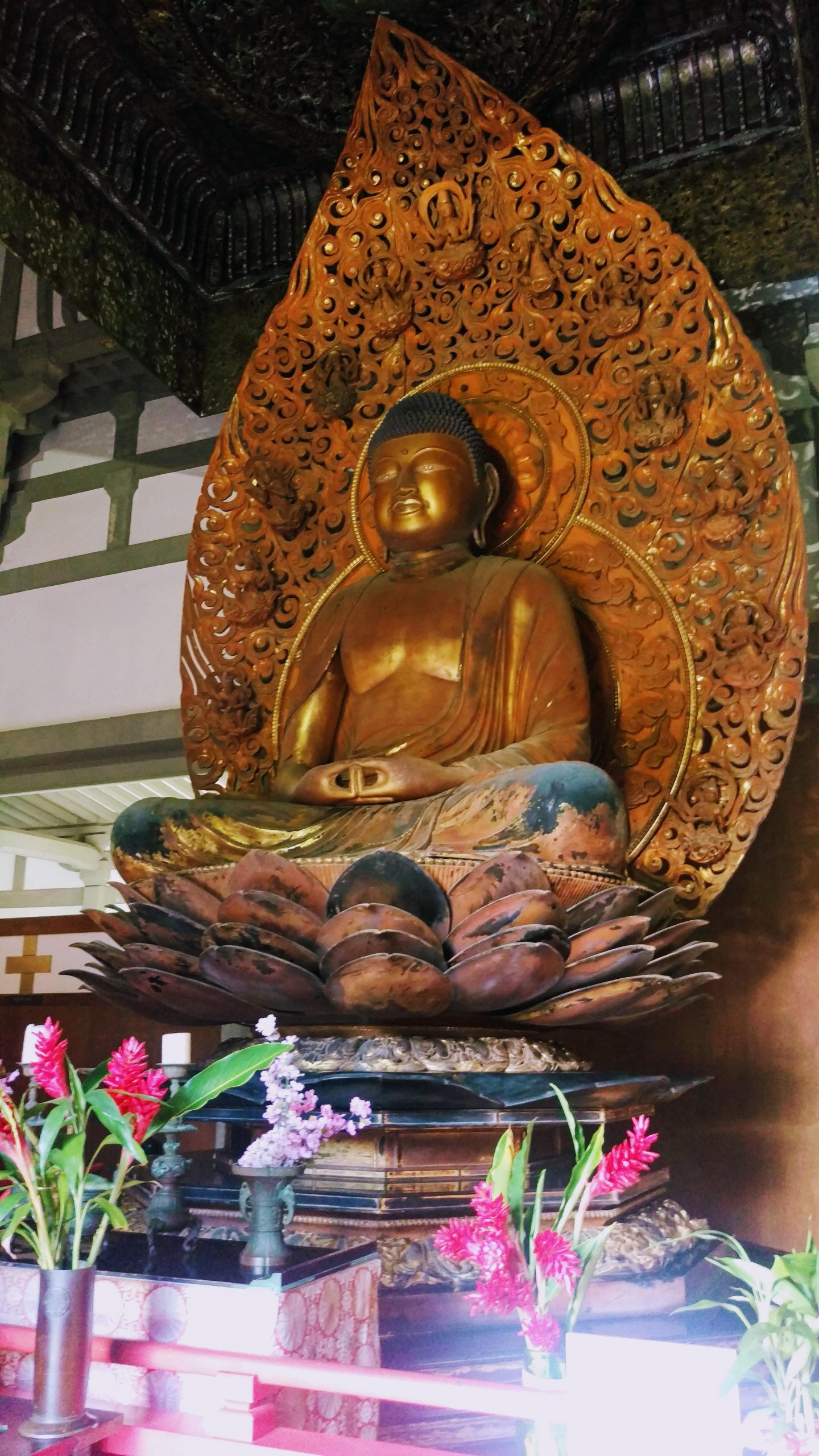 Large gold Buddha statue at Hawaii's Buddhist Temple