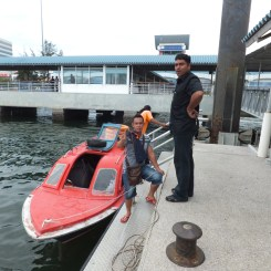 Alighting at Labuan Jetty - Friendly Staff