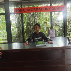 My nephew pretending to be the receptionist at Sungei Palas BOH Tea Centre Tour Information Counter