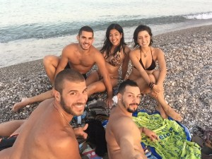 Alex, Tami, Minas, and Kosta on the beach in Rhodes, Greece