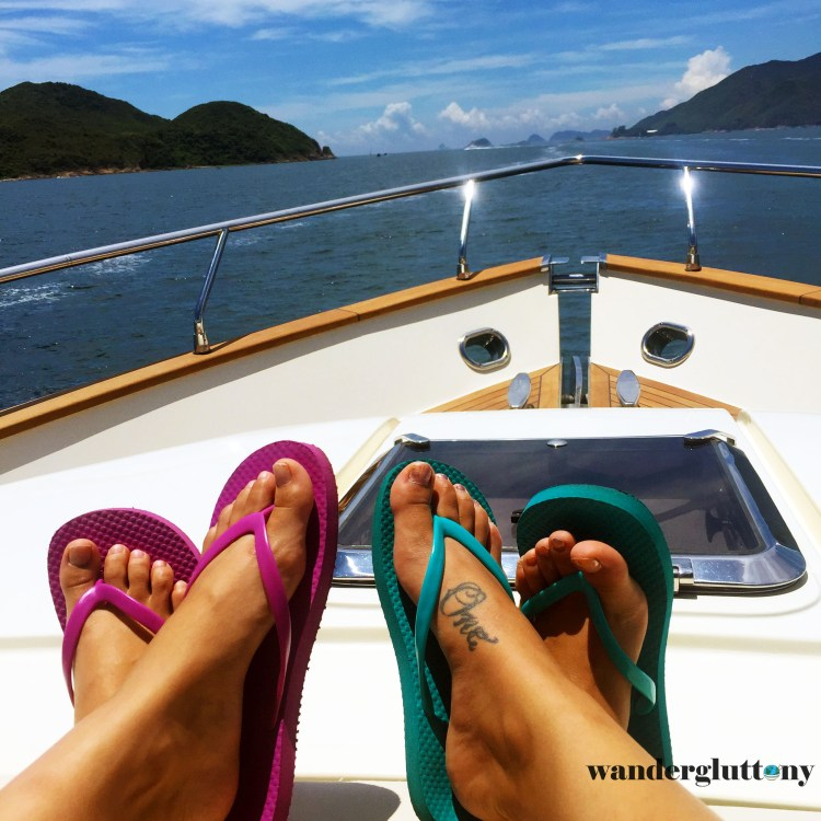 You never know when your $1 shower shoes will double as your footwear on the multi-million dollar yacht. Why bother packing around every perfect pair of shoes, only to spend all your travel time lugging them around? This and more tips for surviving out of a suitcase. #travel #wanderlust #wandergluttony