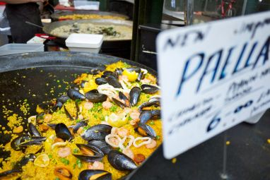 Sizable Pan of Paella for Lunch-goers.