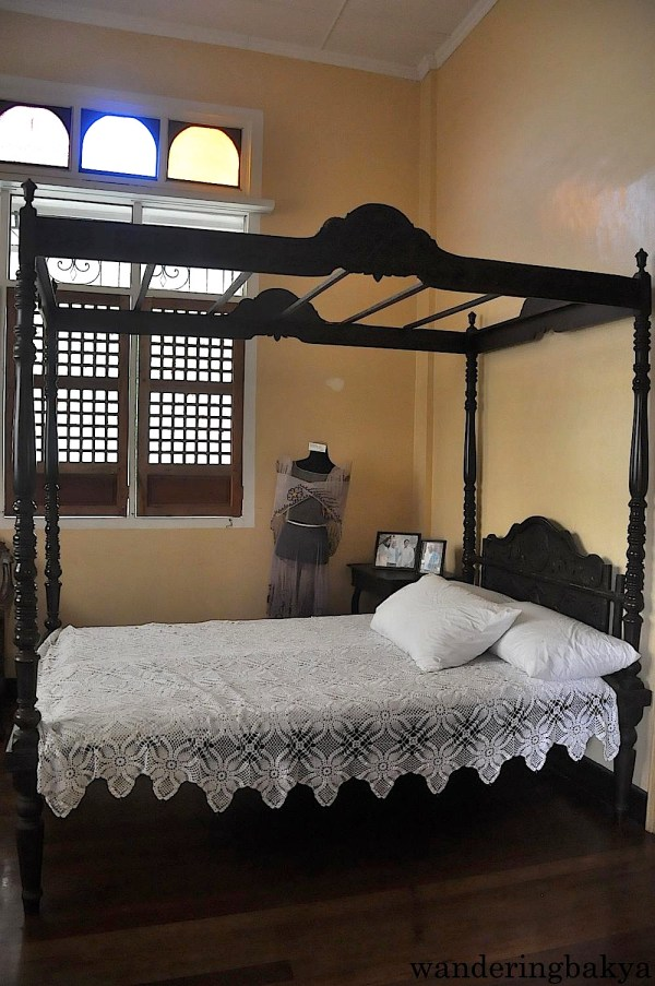 Doña Aurora's room is dominated by a narra bed. The photos on the bedside table were taken during the inauguration of the Quezon Heritage House, a little over a year ago.