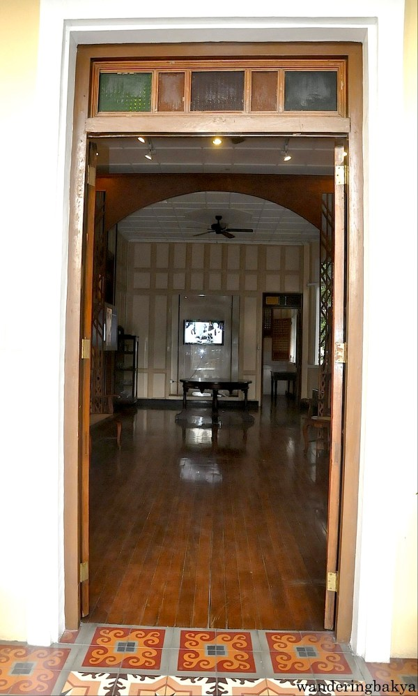 This door leads to a simple sitting area and living quarters of the Quezons
