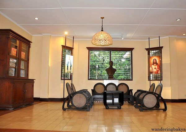 The sitting room on the ground floor. The chairs are replica and the religious images are representations of the carved narra images of Jesus and Mary. Nini decided to keep them as the only material remembrance of her parents.