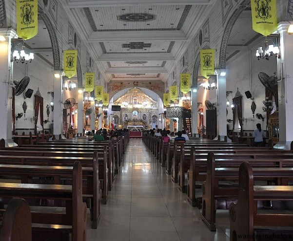 The interior of Barasoain Church features frescoes of angels and saints.